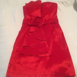Red strapless cocktail dress with rose detail